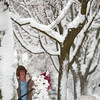 "Record-Eagle/Jan-Michael Stump<br /> Terrie Cady shovels the walk outside her home on West Tenth Street in Traverse City on Wednesday. ""They said it would be wet and heavy; they were right,"" she said."
