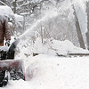 "Record-Eagle/Douglas Tesner<br /> Gerald Schaub, of Traverse City's Central Neighborhood, blows snow out of his driveway on Friday. ""We've had too much snow already,"" he said."