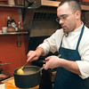 Record-Eagle/Douglas Tesner<br /> Cook Jeremy Heisey prepares a meal at The Cook's House in Traverse City. The bistro uses all local foods.