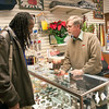 Record-Eagle/Douglas Tesner<br /> Tom Lemcool, owner of the concession gift shop at Cherry Capital Airport, explains a Petoskey stone to traveler Harold Harris from Washington, D.C.