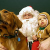 Record-Eagle/Garret Leiva<br /> Anders Lyons, 11 months, and golden retriever, Sophie, 2, both sit patiently on Santa's lap Sunday at the Cherryland Humane Society. For a donation, pet owners could get a photo with Santa at the Traverse City animal shelter. The Santa Paws open house also featured a pet contest, door prizes and tours of the 14,000-square-foot facility.