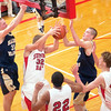 Record-Eagle/Douglas Tesner<br /> Suttons Bay junior Jared Orban (32) battles for a rebound with St. Francis' Ian Sheldon (31) and Sean Sheldon on Friday. The Gladiators won 64-52.