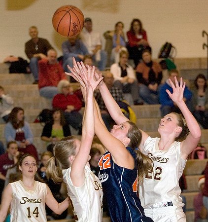 Record-Eagle/Jan-Michael Stump<br /> Traverse City Bulldogs guard Ellisha Crosby (42) drives for a layup against Traverse City Christian's Emily Ritema (12) and Katie VanVreede (22).