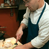 Record-Eagle/Douglas Tesner<br /> Cook Jeremy Heisey prepares a meal at The Cook's House in Traverse City.