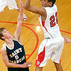 Record-Eagle/Douglas Tesner<br /> Suttons Bay's Dwaun Anderson (22) puts up a shot over Ben Schell (5) in St. Francis' 64-52 win over Suttons Bay in the Lake Michigan/Northwest Conference Challenge.