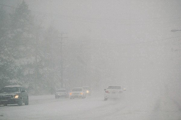 Record-Eagle/Jan-Michael Stump<br /> Drivers make their way down a snowy Garfield Avenue on Thursday afternoon.
