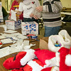 Record-Eagle/Douglas Tesner<br /> Sandra Holsinger, Beverly Jody and Rich Walendowski package stockingsat a Christmas stocking party at VFW post 2789 Saturday.