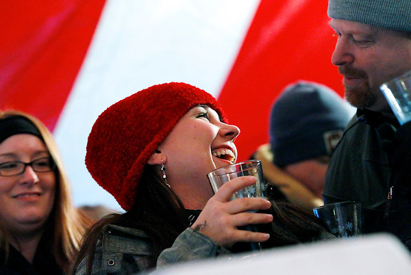 Record-Eagle/Jan-Michael Stump<br /> Kristy Snyder, left, of Traverse City, and Kelly Richter, of Cheboygan, talk over beers at the 2012 Winter Microbrew and Music Festival Saturday at the Village at Grand Traverse Commons.