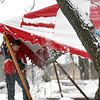 Record-Eagle/Jan-Michael Stump<br /> On Tuesday, Trevor Boomer, of G.J.'s Rentals, helps take down one of the 10 tents from the weekend's 2012 Winter Microbrew and Music Festival  at the Village at Grand Traverse Commons.