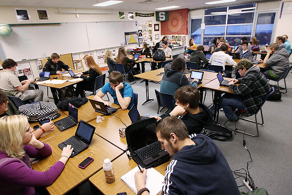 Record-Eagle/Keith King<br /> Traverse City Central High School students use netbook computers in Ben Berger's economics class.