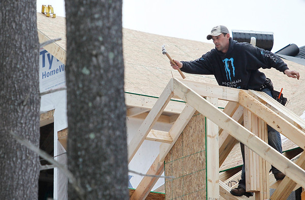 Record-Eagle/Jan-Michael Stump<br /> Kevin Portz, of Portz Builders, works on the roof of a home being built by Pierson-Gibbs Homes on 17th Street. Portz said the mild winter has been a big help in his work.