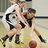 Record-Eagle/Keith King<br /> Traverse City Central's Brianna Podsaid, left, and St. Francis' McKaely Ludka go for the ball Tuesday.