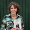 """Record-Eagle/Keith King<br /> Julie Schopieray, author of """"In So Distant a Place as Traverse City: The Northern Michigan Relatives of Elizabeth Bacon Custer,"""" stands Tuesday at the Breeze Hill Greenhouse in Traverse City."""