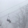 Record-Eagle/Jan-Michael Stump<br /> Skiers ride the chairlift through the fog during the Divison 1 regional championship Thursday at Shanty Creek Resort.
