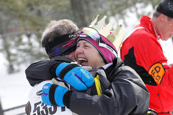 Record-Eagle/Jan-Michael Stump<br /> Women's 24k winner Amy Kostrzwa celebrates with her husband, Ken Roth at Saturday's North American Vasa.