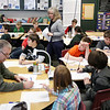 Record-Eagle/Keith King<br /> Dennis Boulanger, left, a Title I teacher, and Julie Mountz, standing, work on a Journey North Mystery Class worldwide Web-based program exercise with fifth-graders at Lake Ann Elementary School.