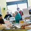 Record-Eagle/Jan-Michael Stump<br /> Employees help customers with their paczki purchases at Potter's Bakery on Tuesday.