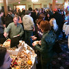 Record-Eagle/Douglas Tesner<br /> Attendees of the Opening Party at the Traverse City Comedy Arts Festival enjoy hors d'oeuvres and conversation in the lobby area of the City Opera House.