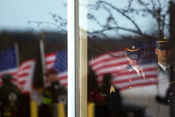 Record-Eagle/Jan-Michael Stump<br /> A U.S. Army honor guard waits inside General Aviation for the arrival of the casket of Sgt. Dillon Black Foxx.