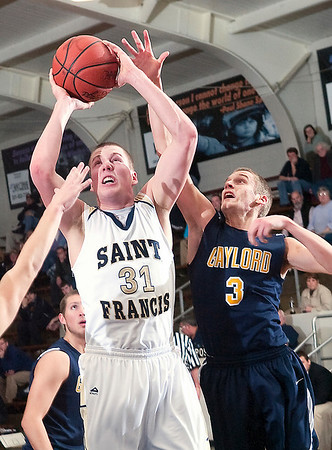 Record-Eagle/Douglas Tesner<br /> St. Francis's Ian Sheldon works his way inside for a shot in Tuesday's game.