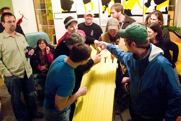 Record-Eagle/Jan-Michael Stump<br /> Competitors line up their cars for a test run before the start of Wednesday night Pintwood Derby races at Right Brain Brewery. Races are organized by brackets, leading to a nightly champion. Points are awarded for the races, as well as aesthetics, towards The Beer Cup series championship.