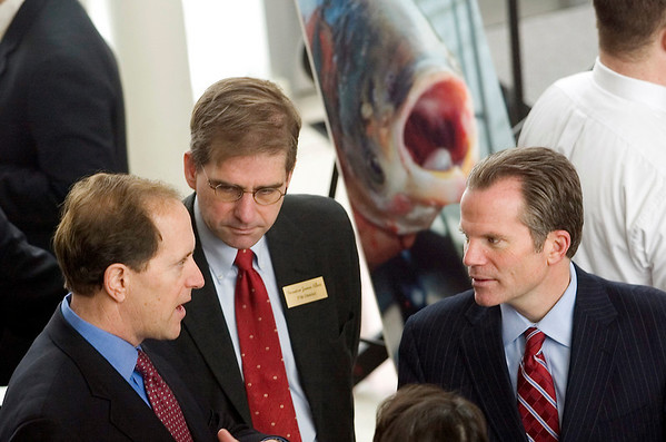 Record-Eagle/Jan-Michael Stump<br /> U.S. Rep Dave Camp, left, State Senator Jason Allen, and Michigan Attorney General Mike Cox talk before the start of a summit Wednesday focusing on the fight to keep Asian carp from the Great Lakes at Northwestern Michigan College's Great Lakes Campus. More than 170 people were in attendance at the event, which also featured local and environmental experts.