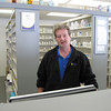 Record-Eagle/Alex Piazza<br /> Dale Maupin, pharmacist at Medicap Pharmacy, stands in front of his stock of prescription drugs. The pharmacy was broken into last week, the second break-in within two months.