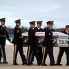 Record-Eagle/Jan-Michael Stump<br /> Family, friends, and honor guards from the U.S. Army and VFW Post 2780 met the casket of Army Sgt. Dillon Black Foxx when it arrived on a flight Thursday at General Aviation in Traverse City. The 22 year-old Traverse City West graduate was killed in action in Afghanistan on Feb. 5.