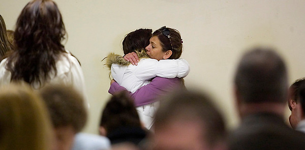 Record-Eagle/Jan-Michael Stump<br /> Trina Pfau, right, mother of slain Army Sgt. Dillon Black Foxx, and Foxx's girlfriend Erika Porter hug during a luncheon Friday following a memorial service with military honors for Sgt. Foxx, who was killed in Afghanistan Feb. 5, 2010.