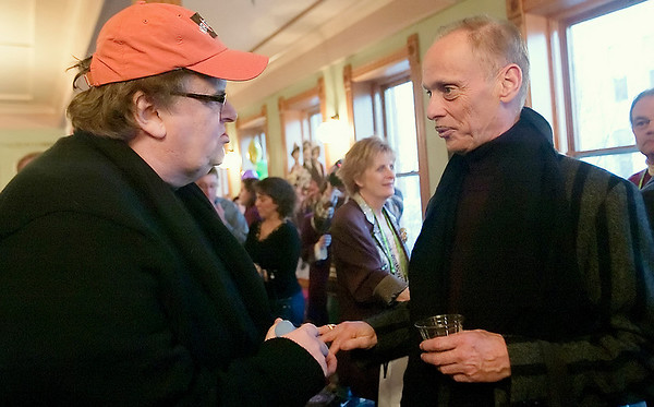 Record-Eagle/Douglas Tesner<br /> Michael Moore and comedian John Waters greet each other during the Opening Party Traverse City Comedy Arts Festival in the lobby of the City Opera House.