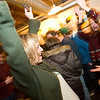 "Record-Eagle/Jan-Michael Stump<br /> Angel Elsenheimer, left, and Anne Cunningham celebrate after the race marshal declares their car, Montessori Mercury,"" a winner during Wednesday night Pintwood Derby races at Right Brain Brewery."