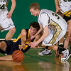 Record-Eagle/Jan-Michael Stump<br /> Traverse City West's Graeme Placek (30) Manistee's Gus Lagerquist (44) fight for a loose ball in the third quarter of Monday's game.