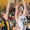 Record-Eagle/Jan-Michael Stump<br /> Traverse City West's Jake Fisher (32) goes for a layup past Manistee's Tim Jensen (32) in the third quarter of Monday's game.
