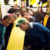 Record-Eagle/Jan-Michael Stump<br /> Competitors watch the finish of a test run of Wednesday night Pintwood Derby races at Right Brain Brewery. Races are organized by brackets, leading to a nightly champion. Points are awarded for the races, as well as aesthetics, towards The Beer Cup series championship.