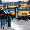 Record-Eagle/Douglas Tesner<br /> Students leave Suttons Bay Public Schools and head toward buses. The district is considering shifting student transportation responsibilities to the Bay Area Transportation Authority as a cost-saving measure.