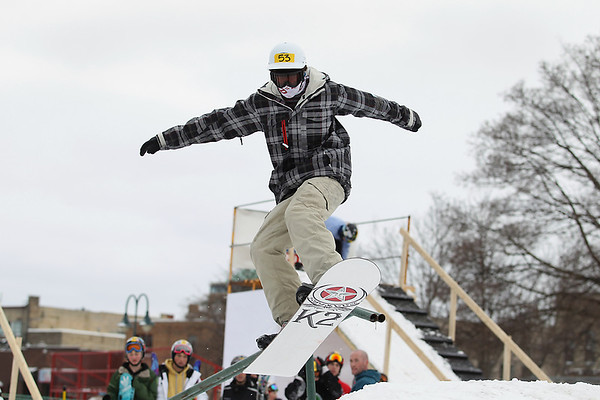 Record-Eagle/Keith King<br /> Caelan Cooper, 13, of Traverse City, participates in a practice session of the Curb Crusher Rail Jam Saturday during the Cherry Capital Winter WowFest.