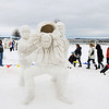 Record-Eagle/Keith King<br /> Attendees of the Cherry Capital Winter WowFest look at snow sculptures as they walk past a sculpture from Johnnie Martinez, Mark Mishler and Logan Mishler near the Open Space.