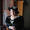 Record-Eagle/Vanessa McCray<br /> Joan Julin, of Traverse City, shows off her rhinestone-encrusted black ensemble. Julin is starting a social sorority for women called the Black Diamond Lillies, and its members will wear black hats.