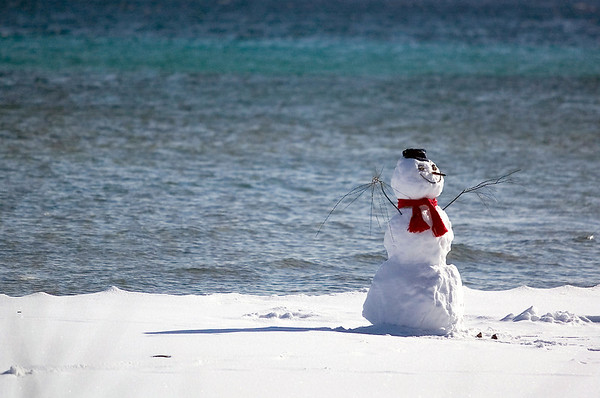 "Record-Eagle/Jan-Michael Stump<br /> Todd and Jaime Hall built a snowman near the water's edge at their home on Center Road on Old Mission Peninsula, but didn't think it would appeal to as many people as it has. ""I don't know why he's getting all the attention, but he does,"" said Jaime, who added that people have been stopping to take pictures since they built him."
