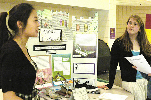 "Record-Eagle/Lisa Perkins<br /> Traverse City East Middle School students Jami Chung and Elena Rothney present their exhibit ""A Walk in Her Shoes: Cultural Innovation through the Cinderella Story"" to judge Jeanette Mason during Saturday's Michigan History Day 2010 competition."