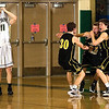 Record-Eagle/Jan-Michael Stump<br /> Traverse City Central's Dylan Roe (30) and Mack Sovereign (far right) celebrate Erik Krueger's game-winning shot as Traverse City West's Luke Hessler (11) reacts to the buzzer-beating three-pointer.