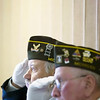 "Record-Eagle/Jan-Michael Stump<br /> Mike Lempinen, left, and Jim Carlson salute during a memorial service for Edgar Nau at the Traverse City Senior Center. The service featured an honor guard from VFW Post 2780, who performed a memorial flag folding and played taps after friends shared memories of the Marine staff sergeant. Nau, who fought in the Solomon Islands and Guadalcanal in World War II in the 1st Battalion of ""Carlson's Raiders,"" was a daily visitor to the center, a member of the center's grief support group and a regular at the Saturday night dances."