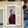 Record-Eagle/Jan-Michael Stump<br /> NMC adjunct professor Devin Hill, left, and carpentry student Richard Anthony assemble a small-scale home built by construction technologies carpentry students and displayed at this weekend's Home Expo, sponsored by the Home Builders Association of the Grand Traverse Area, Friday at Traverse City East Middle School.