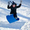 Record-Eagle/Jan-Michael Stump<br /> Sara Burton, 8,  flies off a jump while sledding with her brother Jack, 10, at the Grand Traverse Civic Center on Wednesday afternoon.