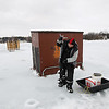Record-Eagle/Keith King<br /> Vern Coblentz, of Grawn, uses an auger to drill a hole for ice fishing on Cedar Lake in Leelanau County.