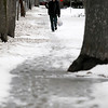 Record-Eagle/Jan-Michael Stump<br /> David Freundl walks down Union Street after shoveling his grandfather's walk on Wednesday afternoon.