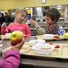 Record-Eagle/Jan-Michael Stump<br /> Head Start students Taylin Pagel, left, and Nikolas Hatton, right,  eat breakfast Thursday at Traverse Heights Elementary School, which will showcase its fresh food program during Gov. Rick Snyder's visit today.
