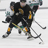 Record-Eagle/Jan-Michael Stump<br /> Traverse City Central forward Marcus Russell (9) had three assists in the Trojans' 10-2 victory.