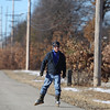 Record-Eagle/Keith King<br /> Lou Platteborze, of Traverse City, uses poles and inline skates last month on the TART Trail.