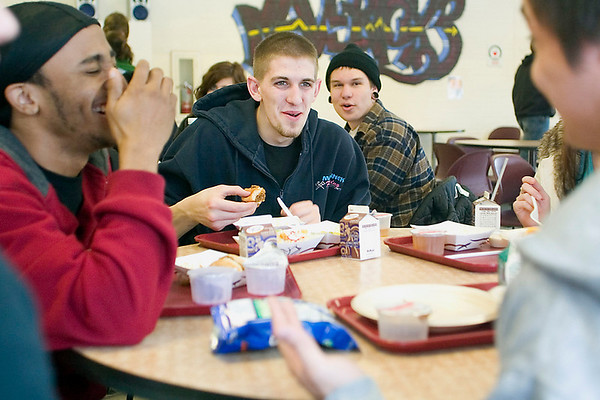 Record-Eagle/Jan-Michael Stump<br /> Kevin Knight Jr. has lunch with Matthew James, left, and other friends. Knight, a senior at Traverse City High School, receives free meals at school and uses the money saved for his 1-month-old son, Kevin.